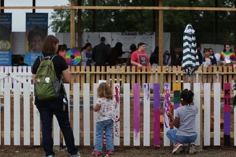 Family Paint the Childrens Garden Fence at our Earthday Festival