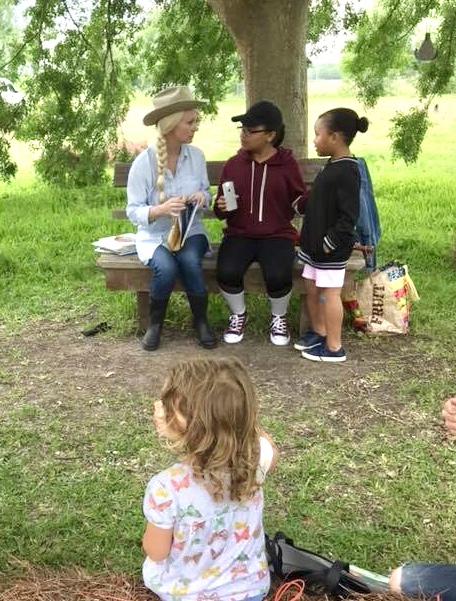 Actor, Laura Bellomy doing Storytime under the Lace Bark Elm at the Earth Day Family Festival